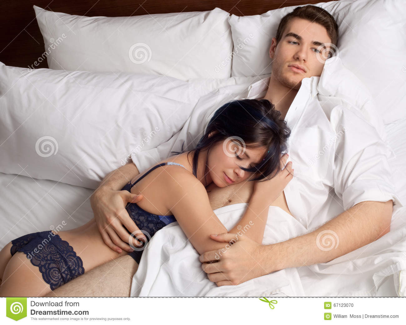 Images of couples cuddling in bed